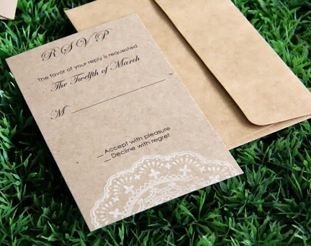rsvp card made of recycled kraft paper with doily stamp in white ink