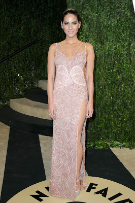 Olivia Munn wearing a Versace Atelier Couture dress and shoes while attending the 2013 Vanity Fair Oscar Party