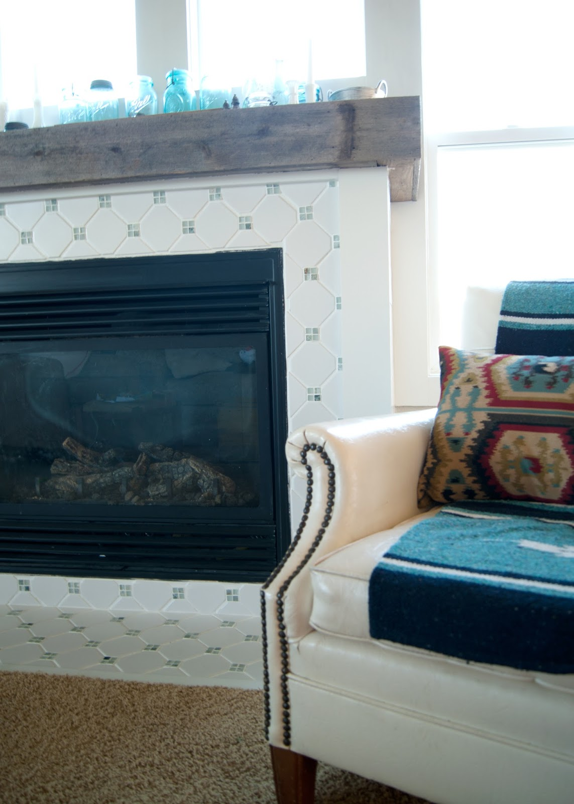 Updated fireplace, vintage chair, horse blanket