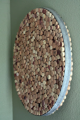 cork art using wine barrel hoop - tipsyterrier.blogspot.com