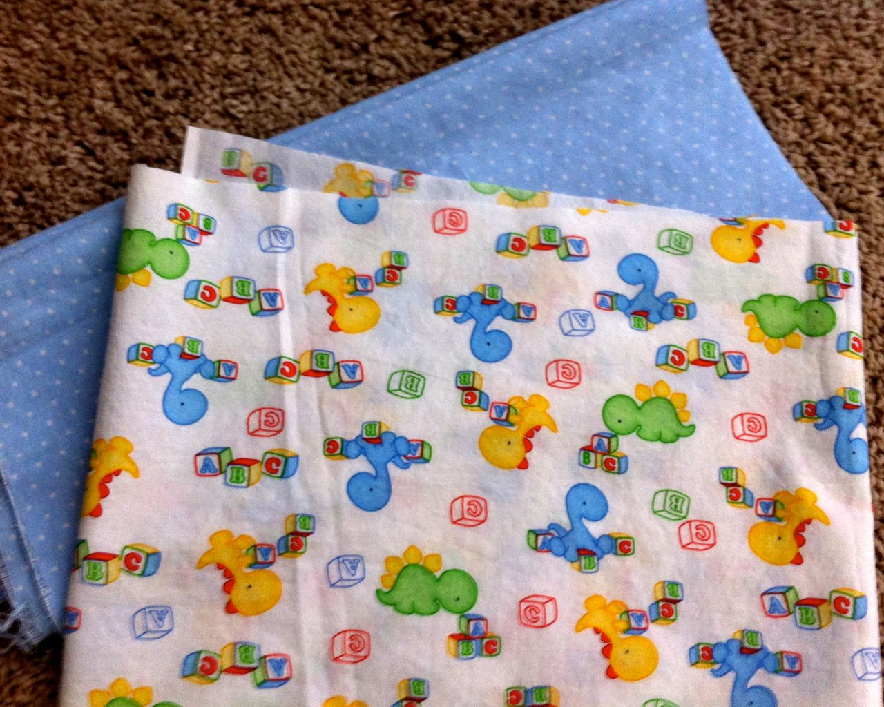 A song of sixpence simple baby quilt for Baby dinosaur fabric