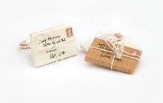 https://www.etsy.com/uk/listing/81090484/cream-miniature-envelope-ring-cream?ref=shop_home_active