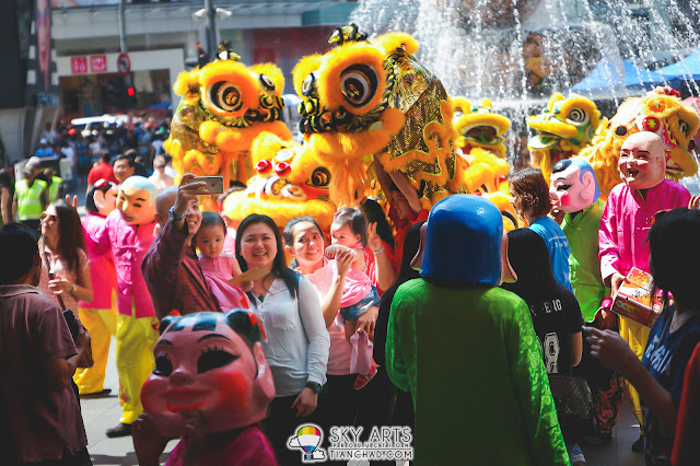 A happy family spotted taking photos with the lion dance outside Pavilion KL