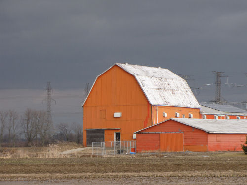 barn against the stormy sky