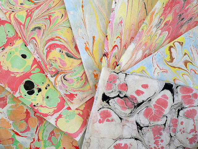 http://www.decoart.com/mixedmediablog/project/352/paper_marbling_made_easy