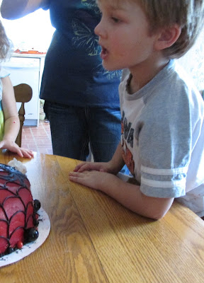Grandson blowing out his candles at his birthday party-Vickie's Kitchen and Garden