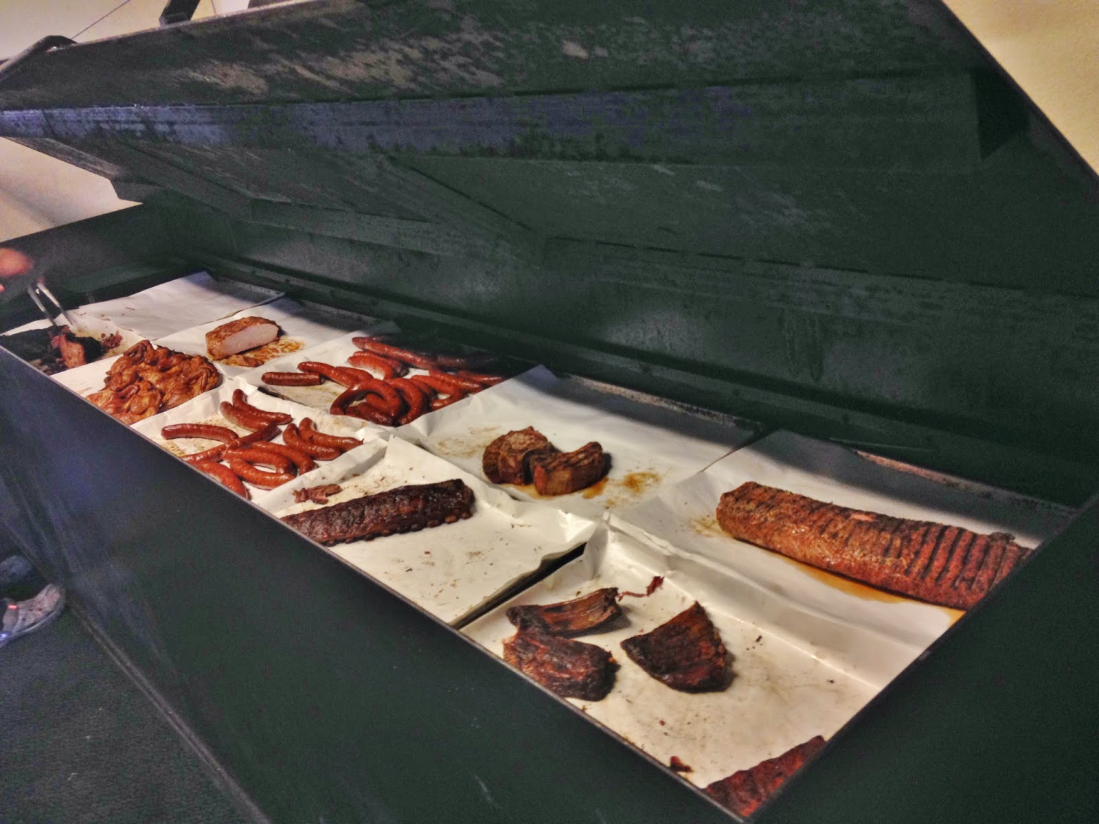 The spread of meats in Opie's pit