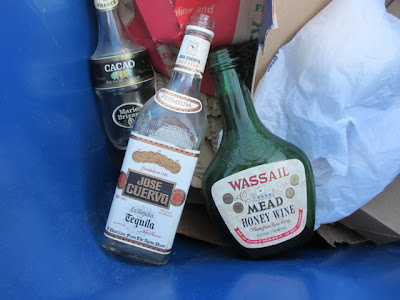 liquor bottles in recycling bin