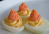 http://happierthanapiginmud.blogspot.com/2015/10/candy-corn-deviled-eggs.html