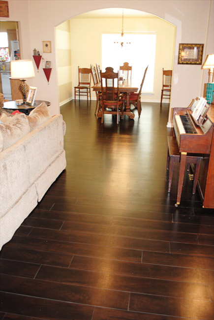 i should be mopping the floor Our New Vinyl Wood FloorsLOVING