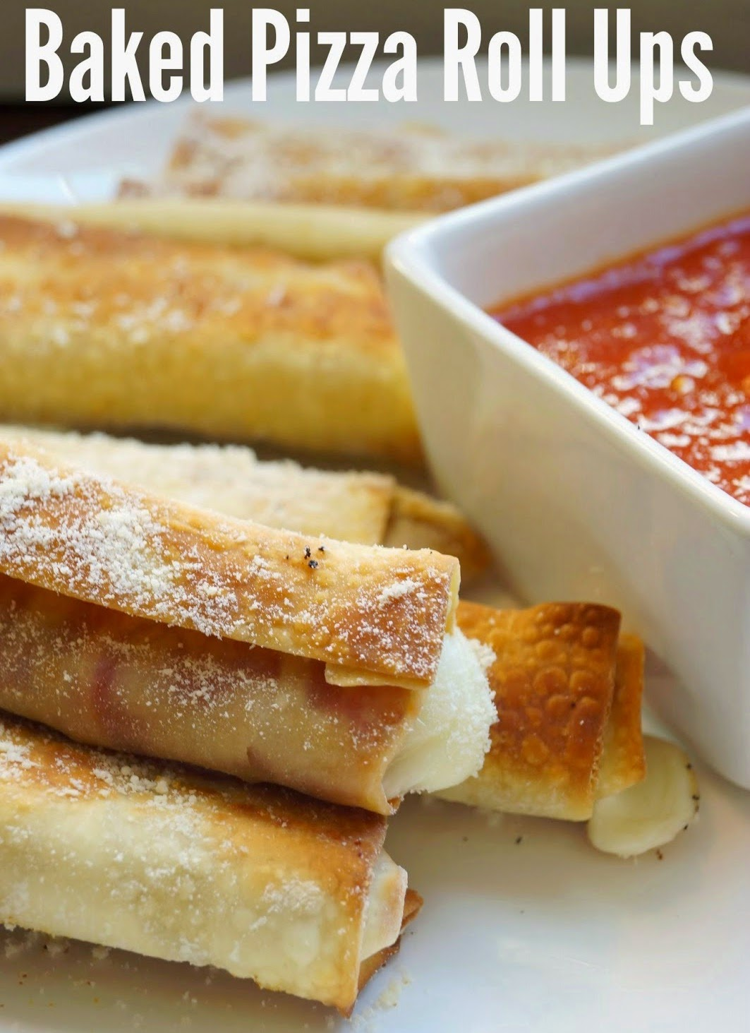 Baked Pizza Roll Ups   A quick and delicious way to prepare pizza! These are made with part skim cheese and turkey pepperoni so are on the healthier side as well!