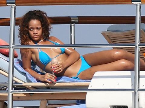 the photos contain about rihanna s bikini show that rihanna