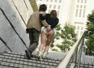 Girl got her skirt lifted up and ass molested in public.