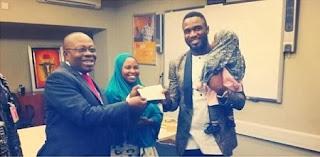 Praiz presenting the cheque