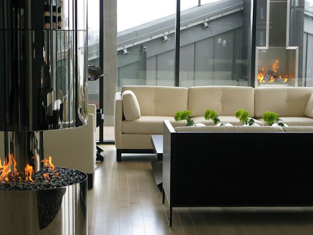 Picture of modern white sofa by the round fireplace in the living room