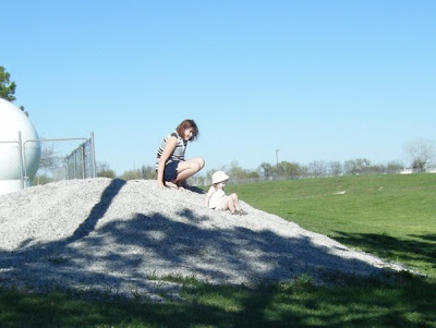 My girls sliding down a gravel hill