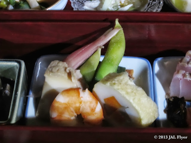 JAL First Class Japanese appetizer: fried bean curd roll with vegetables, steamed abalone, simmered prawn