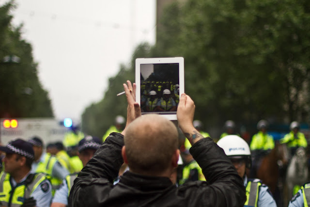 ipad being held at occupy melbourne