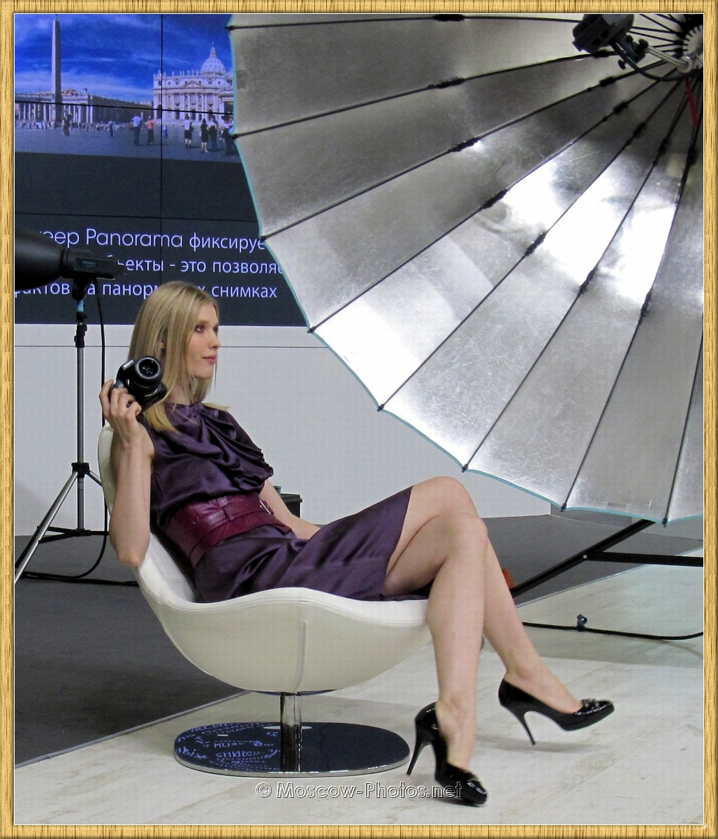 Blonde Russian Model Posing with Sony Photocamera