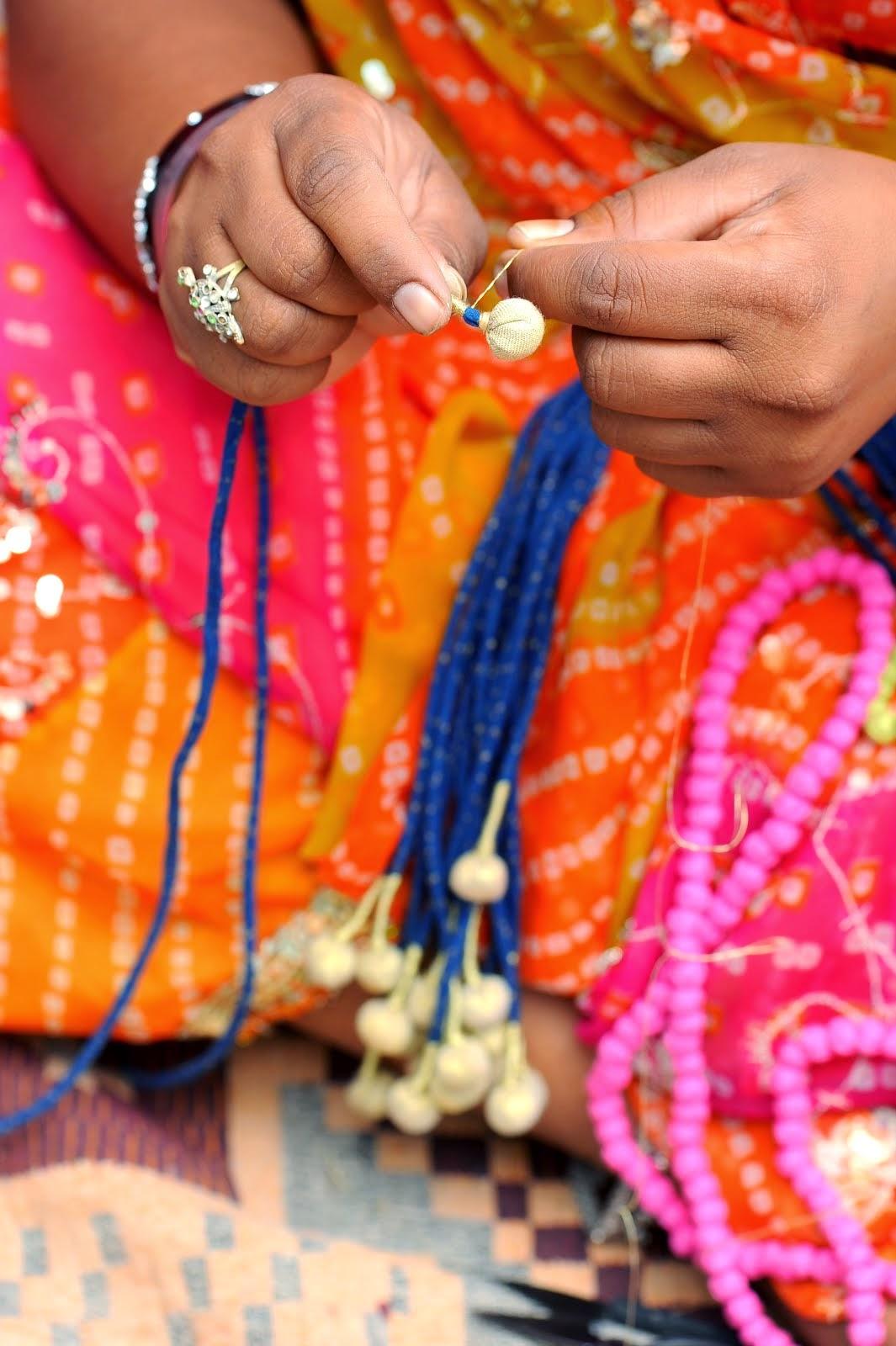 Rural Woman working on beautiful beads