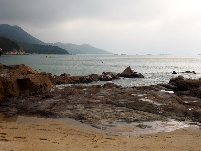 Rock pools and the view out to sea from Hung Shing Yeh beach, Lamma Island, Hong Kong
