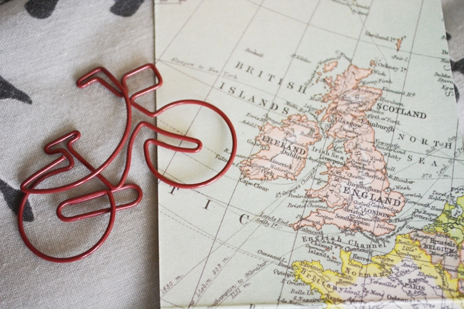 cute bicycle paper clip bike across the world map