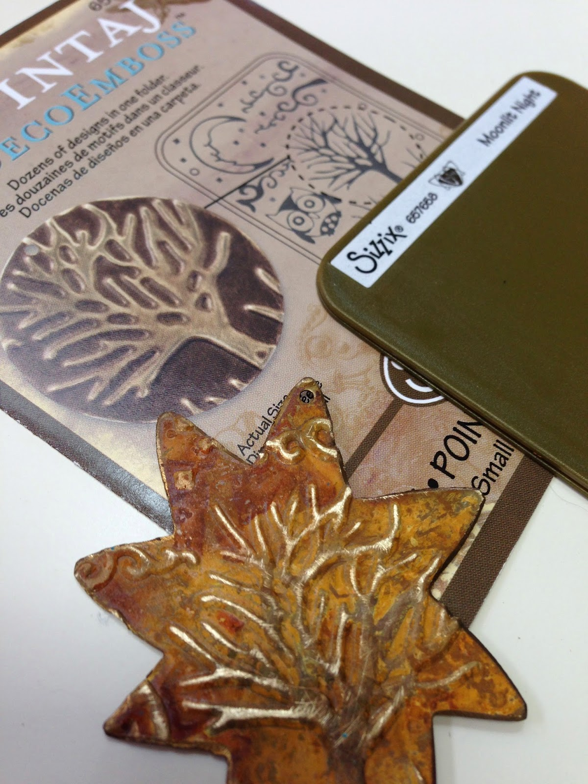 Playing With Paint Using A Cuttlebug Machine To Emboss Metal