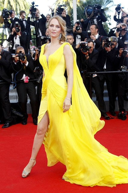 Uma Thurman wore a yellow Atelier Versace gown, featuring a billowing train at Cannes 2014