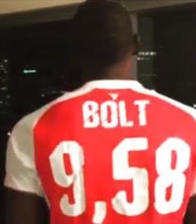 Manchester United fan Usain Bolt forced to wear Arsenal shirt after losing bet!