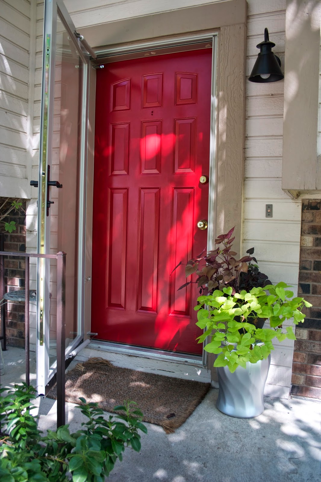 Front door makeover the striped house for Front door with storm door