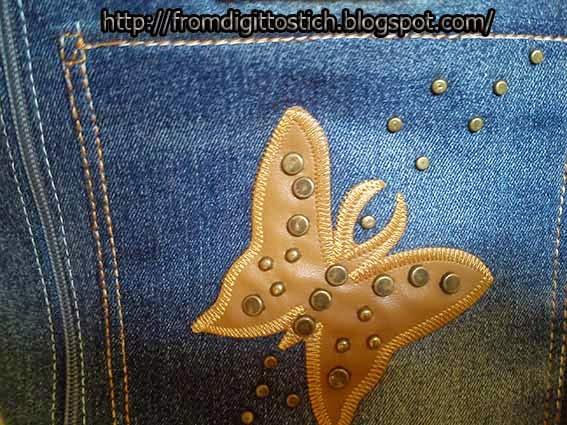 бабочка на джинсе