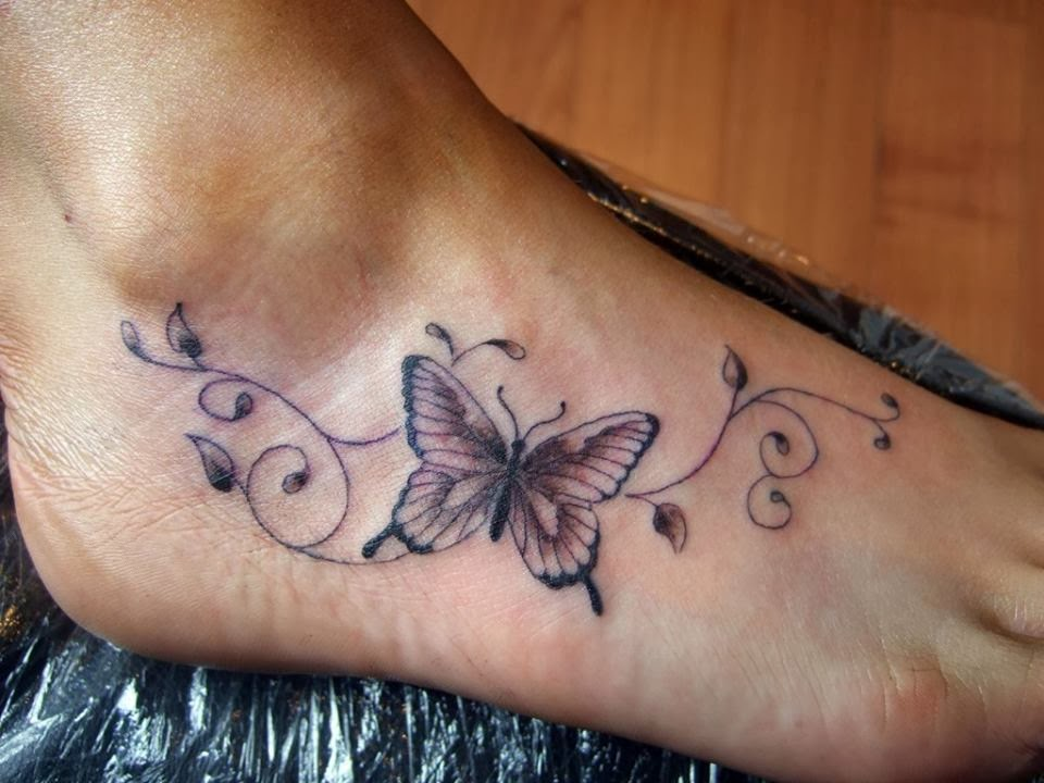 the tattoo magazine butterfly foot tattoo for ladies. Black Bedroom Furniture Sets. Home Design Ideas