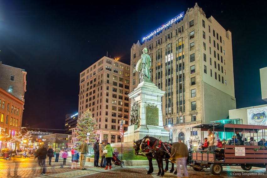 Portland, Maine USA December 2015 Photo by Corey Templeton of Monument Square at night on a First Friday with horse and wagon.