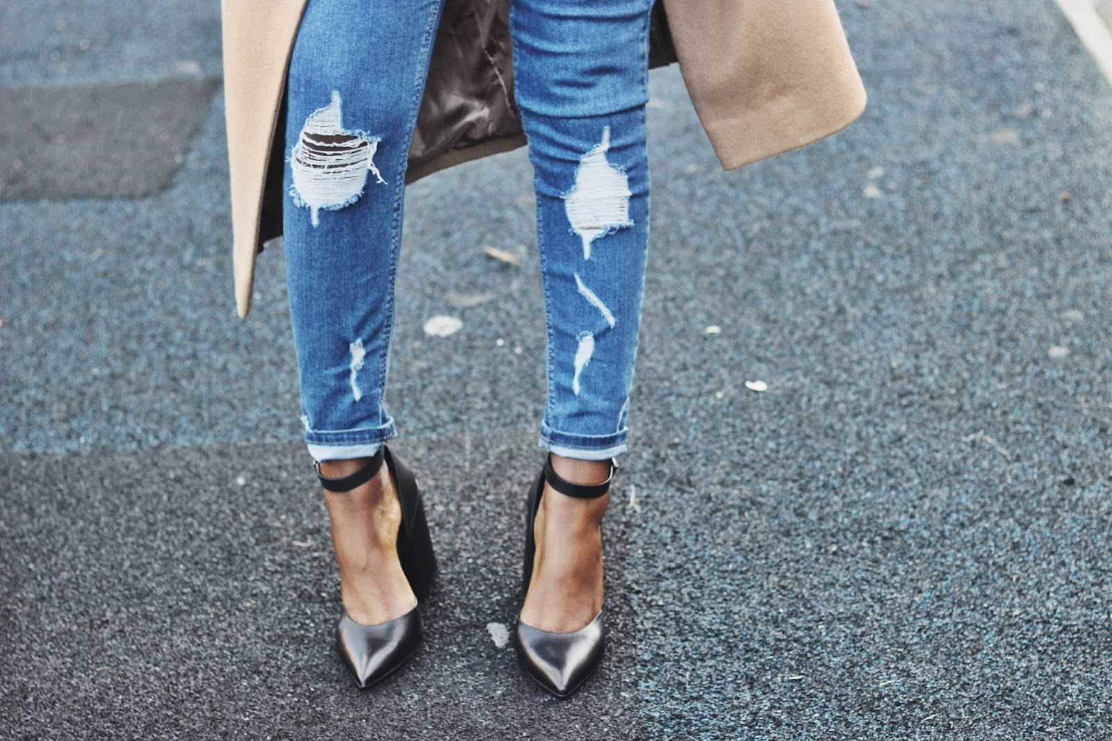 Skinny ripped jeans and pointed heels