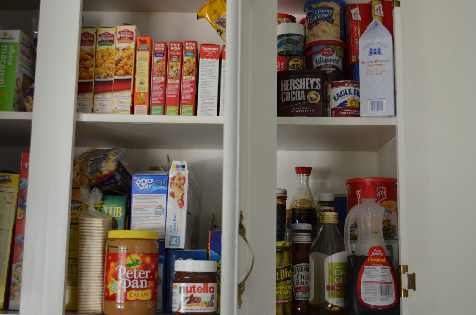 the crunchy country mama kitchen cabinet and pantry reorganization other side of the cabinet after