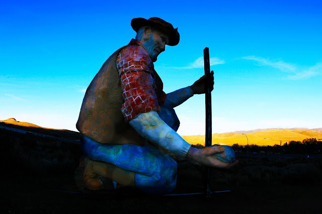 A very large statue of a gold miner somewhere in Nevada.