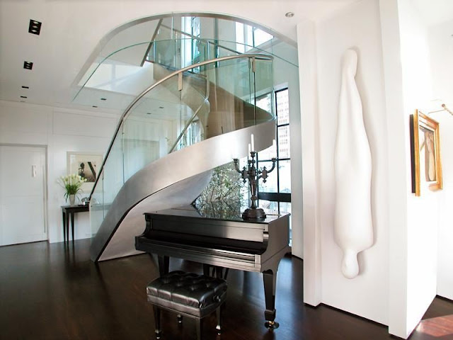 Photo of amazing modern staircase with glassy railing with the piano under the staircase