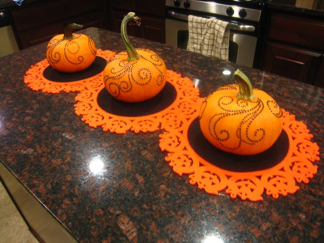 ordinary Pumpkin Kitchen Decor #8: I found the table runner at HomeGoods, picked up the three pumpkins at the  pumpkin patch, and embellished them with rhinestone swirl stickers from  HobLob.
