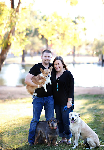 Couple poses with family dogs at a Tucson park