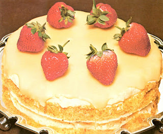 Classic Cordon Blue school cake made with almond meringue layers sandwiched with cream and topped with coffee glace icing and fresh strawberries