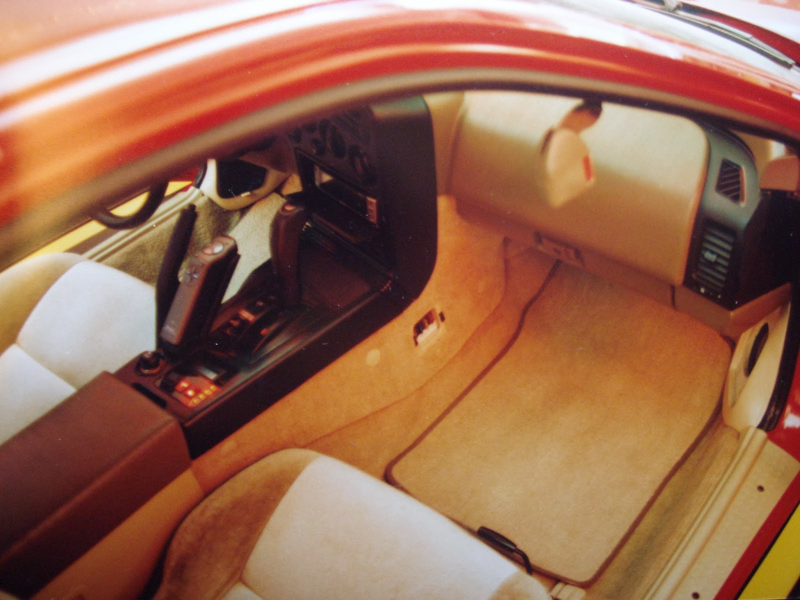 Photo image of the front interior showing the very small kick panel in Chuck Barbosa's Red Laser as it stood during the winter storage at the end of 1995 and beginning of 1996.