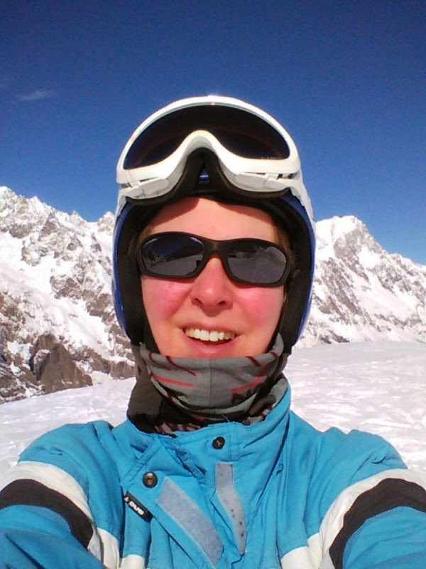 Selfie in ski gear with mountains