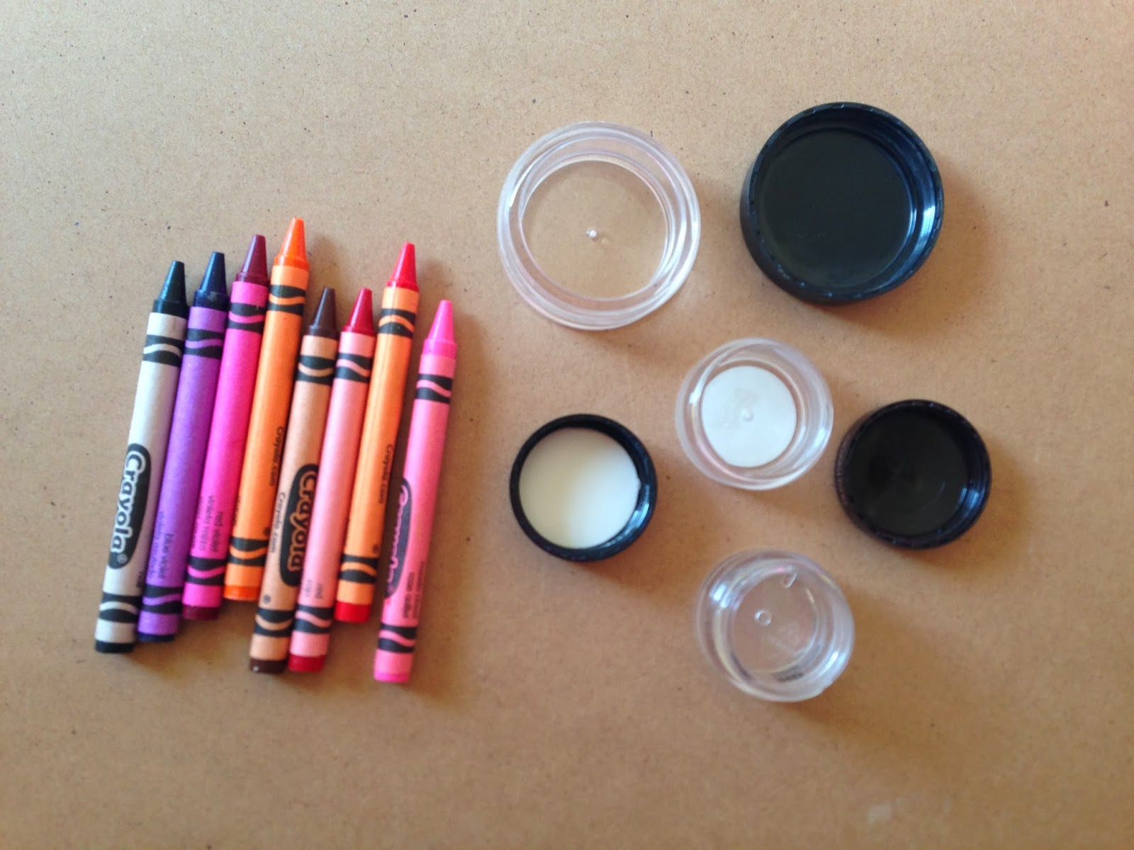 1. Crayons of your choice 2. 1/2 tsp of any type of oil (olive, almond, jojoba, etc.) 3. Vaseline or Shea butter 4. Stick to stir with 5. Small container 6. Heat source (like a candle or a stove top) 7. Metal spoon to heat ingredients in.