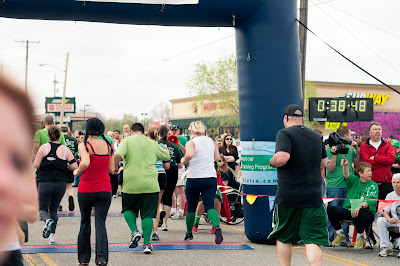 Eric and Jess cross the finish line at the St. Patrick's Day 5K at Runner's World Tulsa