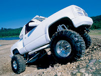 white pick up truck with big wheels