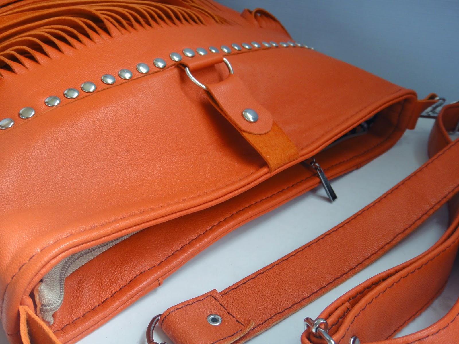 Рыжая сумка из кожи