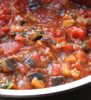 People all over the world sit down to enjoy tasty, nutritious vegan meals every day. Eggplant with tomatoes groundnut sauce is an easy vegan recipe to prepare any day of week, simply serve over rice and enjoy.