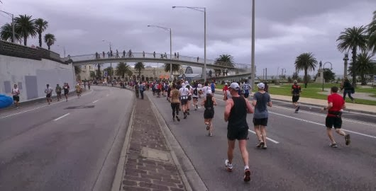 Running down Marine Parade in St Kilda