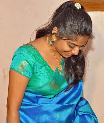 Royal dressed Tamil girl in traditional costumes.