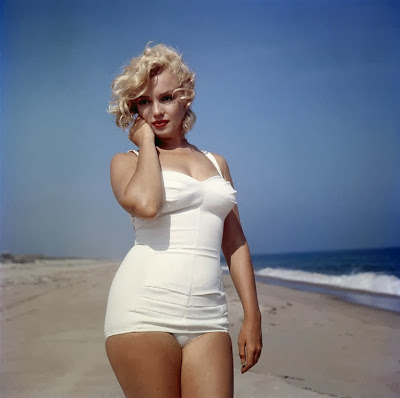 Marilyn Monroe in bathing suit on beach with curves